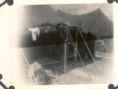 Soldiers in tent barracks during World War II period