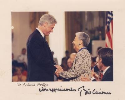 Antonia Pantoja and the U.S President Bill Clinton