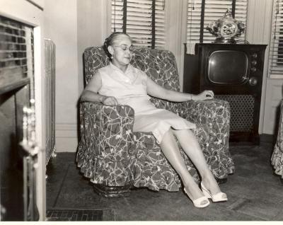 Inocencia Bello Paoli de Torres, wife of Felipe Neri Torres, sitting in an armchair