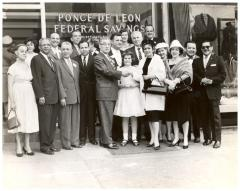 Group of people standing in the front of Ponce de Leon Federal Bank