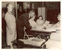 Felipe Neri Torres and his wife Inocencia Bello Paoli de Torres during voter registration