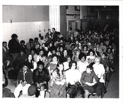 Audience at a community meeting