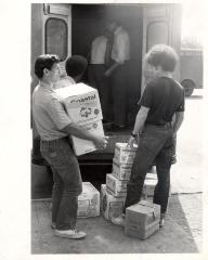 Men unloading boxes of Tropicana products from a truck