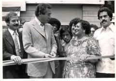 David Billings and Evelina López Antonetty cutting a tape at an event