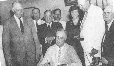 Franklin Delano Roosevelt signing the Social Security Law