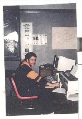 Young man at computer at CHARAS