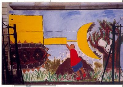 Mural of a figure stopping a bulldozer from destroying a tree