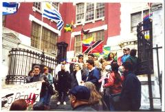 Activists gathered on the steps with flags of cultural pride