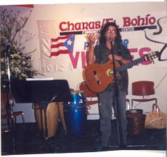Guitar player performing for CHARAS/El Bohio