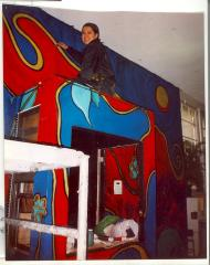 Artist at work on a mural at CHARAS