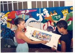 Artists at CHARAS creating a mural