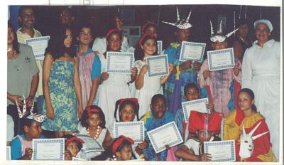 Youths holding certificates