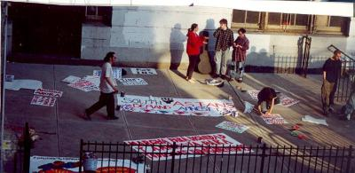 People creating protest signs at CHARAS