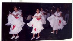 Girls in white dresses in a performance at CHARAS
