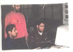 Young men at a computer at CHARAS
