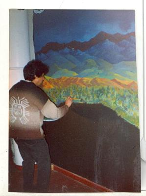 Artist at work on a painting at CHARAS