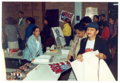 Women at a merchandise table during the ¡MUÉVETE! Boricua Youth Conference