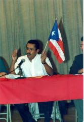 Panelist holding a Puerto Rican flag at the ¡MUÉVETE! Boricua Youth Conference