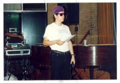 Man in white shirt that reads Despierta Boricua (Wake Up Boricua) at piano