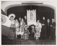 Mexican people onstage celebrating La Virgen de Guadalupe day