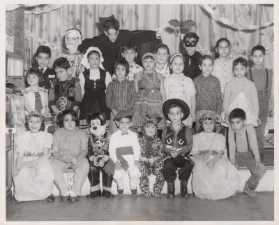A group of kids in a Halloween celebration
