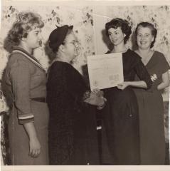 Genoveva de Arteaga giving a certificate to a young woman