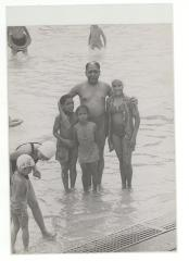 Jesús Colón with his children at the swimming pool