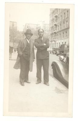 Jesús Colón (right) with friend on city street