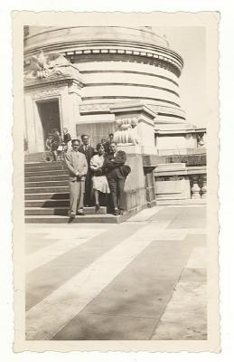 Jesús Colón with others in front of a building