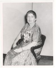 Woman in floral dress sitting