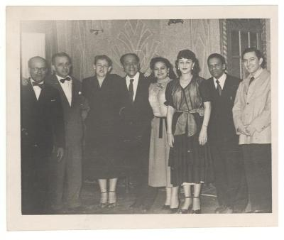 Jesús Colón with others at a formal event