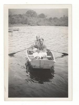 Jesús Colón on rowboat with friend