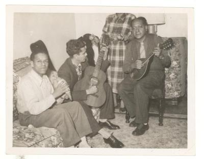 Jesús Colón playing mandolin with friends