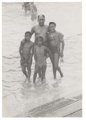 Jesús Colón and his children at the swimming pool