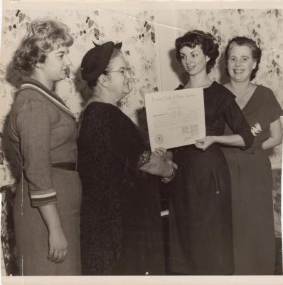Genoveva de Arteaga giving a certificate to a young woman