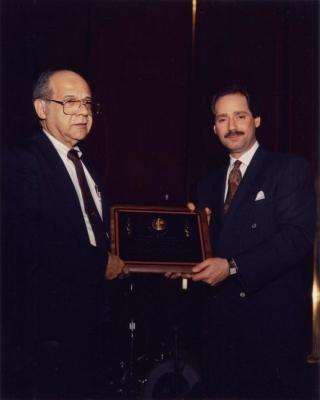 Frank Torres and Fernando Ferrer holding a plaque