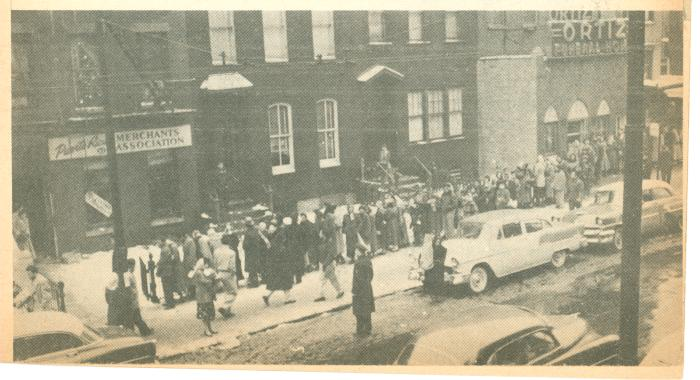 Crowds in front of Puerto Rican Merchants Association
