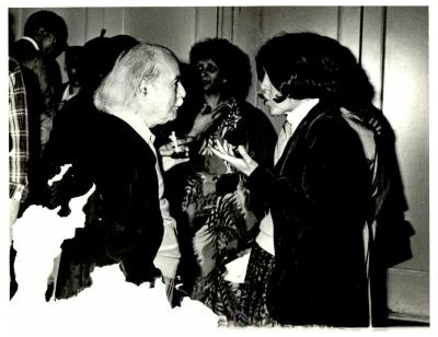 Clemente Soto Velez listening to an unidentified woman