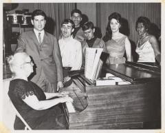 Genoveva de Arteaga teaching piano lessons