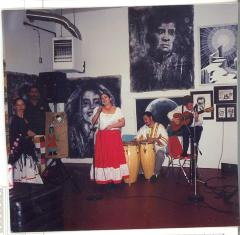 Music band performing in front of artwork