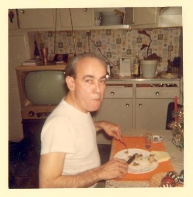 Clemente Soto Velez at home eating a meal