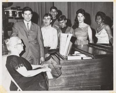 Genoveva de Arteaga teaching piano lessons