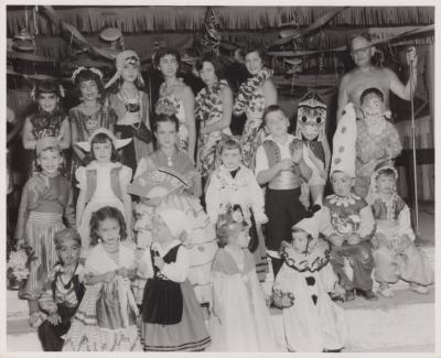A group of children wearing costumes