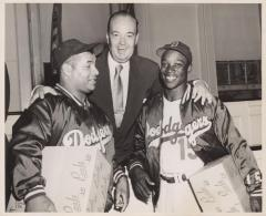 Two Dodgers team players and Walter O'Malley