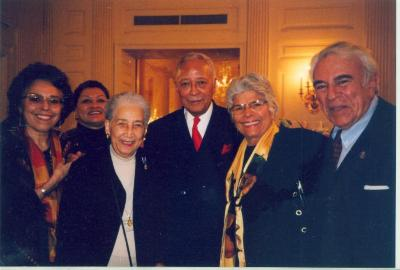 Helen Rodríguez-Trías (in yellow scarf) with New York City Mayor David Dinkins