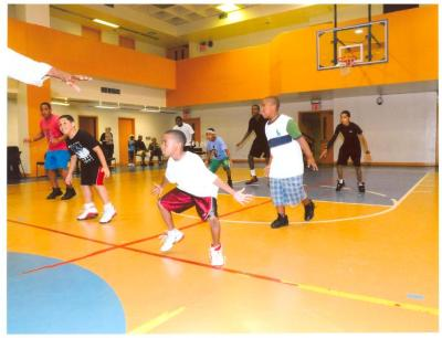 """Basketball players during """"Hoops for Haiti"""" fundraiser"""