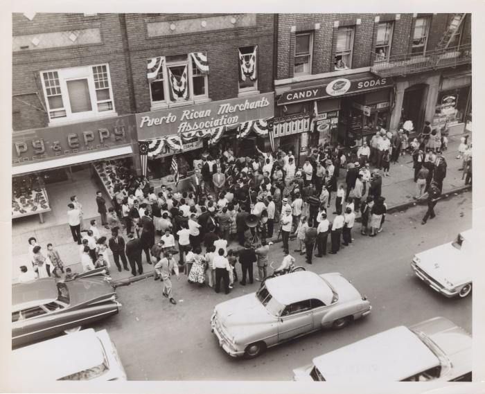 A multitude in front of the Puerto Rican Merchants Association