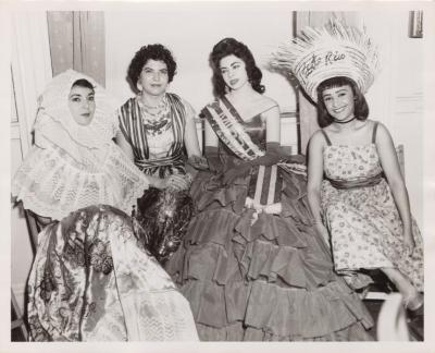 Cuban beauty queen and 3 women in folkloric dresses