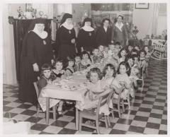 Students of the San Jose de la Montana Asilo school assembled for lunch