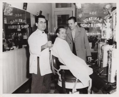 Three men at a barber shop